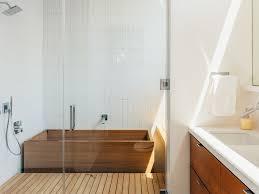 bathroom medium tone hardwood floors large trendy walk in shower