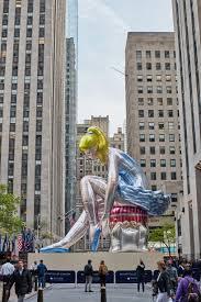 jeff koons inflates 45 foot high seated ballerina in rockefeller