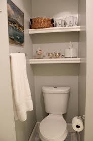 over the toilet shelf chic towel shelf above ceramic toilet above