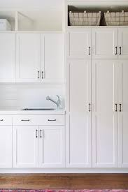 White Cabinets For Laundry Room All White Laundry Room Features White Shaker Cabinets Adorned With
