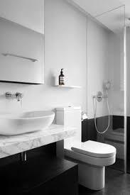 bathroom shelf styling black white glass ceramics basketware