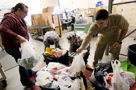 thanksgiving drive file us navy 111123 n hw977 185 sailors weigh thanksgiving food