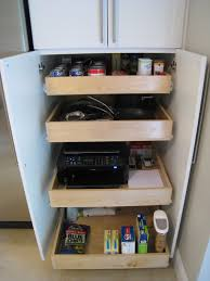 pull out drawer pots and pans storage in wood cupboard ideas