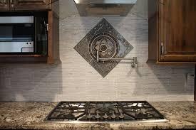 bronze backsplash medallions over stove elegant kitchen photo in