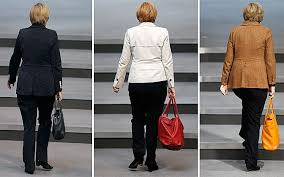 Germany     s record trade surplus is a bigger threat to euro than     The Telegraph Angela Merkel  carrying handbags that make up the colours of the German national flag