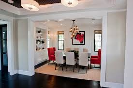 pretty arteriors lighting in dining room transitional with