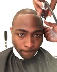 show nigerian celebrity hair styles lovely photo of davido getting a hair cut in london ahead of his