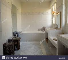 modern bathroom with pale grey tiled floor and small moroccan