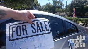 cars for sale putting for sale signs on random cars