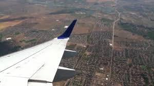 North Dakota travel flights images Frontier airlines embraer e190 takeoff from denver international jpg