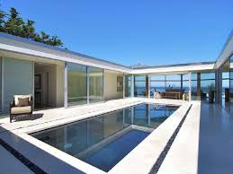 modern swimming pools comfy white mattress above green grass glass modern swimming pools comfy white mattress above green grass glass wall at the pool black painted iron chair white tile floor the edge of the pond amazing
