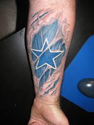 dallas cowboy star ripped skin tattoo on lower arm tattooshunt com