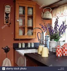 kitchen wall cabinets vintage vintage enamel storage jars and jugs on draining board