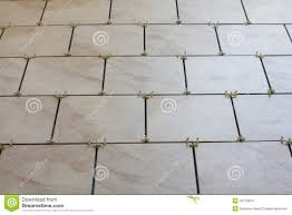 Installing Floor Tile Installation Of Floor Tiles And Spacers Stock Images Image 19179814