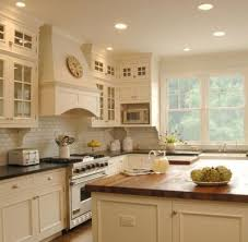kitchen backsplash ideas with cream cabinets soapstone butcher block counters with cream cabinets subway tile