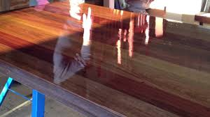 the varnish is applied to the 8 seater hardwood dining table by