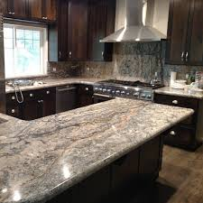 what backsplash looks with cherry cabinets favorite granite counters to top cherry wood cabinetry