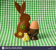bunny egg cup egg in an egg cup with a easter bunny egg cosy stock photo