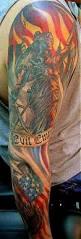mallteliti cross and american flag tattoos