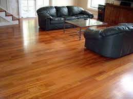 Scraped Laminate Flooring Flooring Traditional Living Room With Black Leather Sofa And