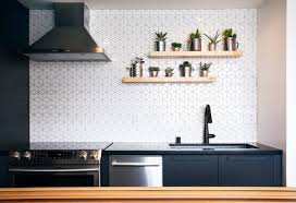 black kitchen cabinets in a small kitchen 75 beautiful small kitchen with black countertops pictures