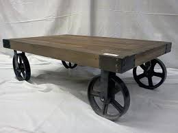 reclaimed wood coffee table with wheels vintage factory carts double as trendy coffee tables