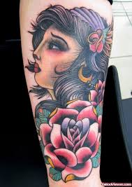 red flower and gypsy tattoo on arm tattoo viewer com