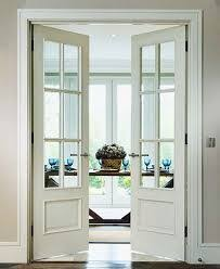 french doors interior frosted glass interior bifold doors with casement windows above house