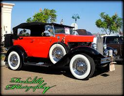a fully restored 1931 ford model a with a two tone paint job and