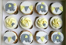 grey yellow and white elephant and bunting baby shower cupcakes