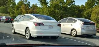 tesla model 3 new white release candidate shows clear design