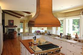 excellent oak wood cabinets flanking classic copper hood material