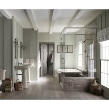 bathroom cozy lowes wood flooring with white baseboard and kohler