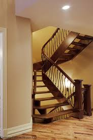 custom curved stair with s shaped spindles and mariner posts by