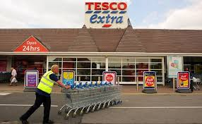 tesco profits cut by half after us failure american stores will