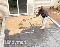 How To Lay Flagstone Patio How To Cover A Concrete Patio With Pavers Family Handyman