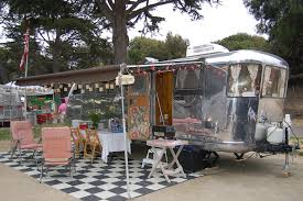 vintage 1947 spartan manor trailer with large awning setup for