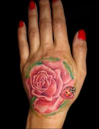 hand on shoulder tattoo flower tattoo tattoos so realistic pink rose flower and