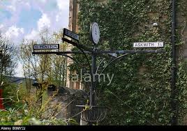 a wrought iron direction sign post seen as ornamentation in the