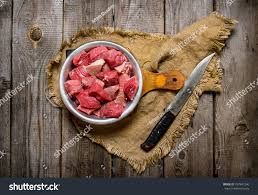 meat cutting table tops cutting raw meat large knife on stock photo royalty free 357941240