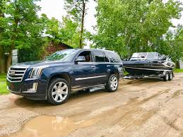 cadillac jeep 2017 white towing a boat with the 2017 cadillac escalade 6 things you need