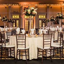 wedding table and chair rentals tables lots of candles and mahogany chiavari chairs