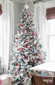 White Christmas Tree With Blue Decorations Bhg Style Spotters