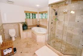 traditional master bathroom with drop in bathtub frameless