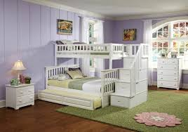 over full bunk bed with stairs and trundle