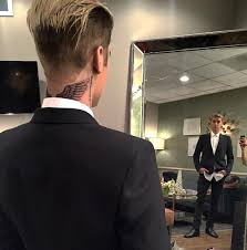 small angel wing tattoos on back justin bieber gets new angel wings tattoo on the back of his neck