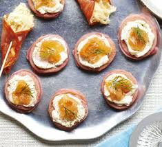 canape a top light blinis with cheese and smoked fish for a