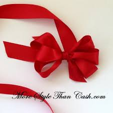 tying gift bows make a gift bow