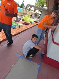 home depot team paints olive wood child development center