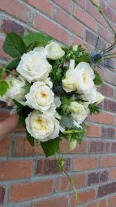 bridal bouquet with white garden roses white anemones thistles